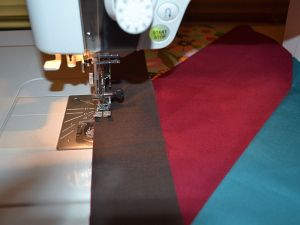 Next, I stitched the narrow strips in between and around the columns.